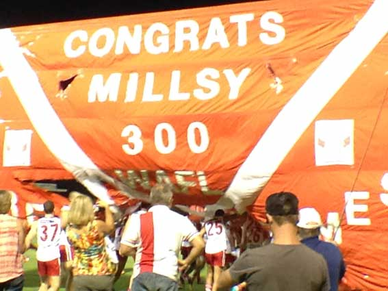 South Fremantle players burst through the banner marking Kris Miller's 300th WAFL game. Photo by Les Everett