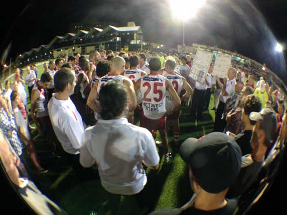 The confident Bulldog huddle at quarter time. photo by Les Everett