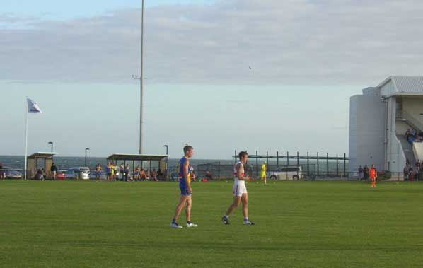 Peter Faulks (left), back from his stint as a Docker, enjoys windy Willy.