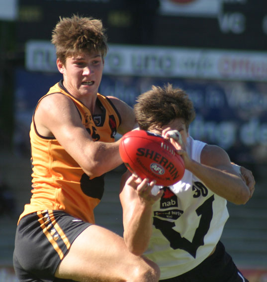 Vic Country's Caleb Marchbank marks strongly at Fremantle Oval. Photo by Les Everett
