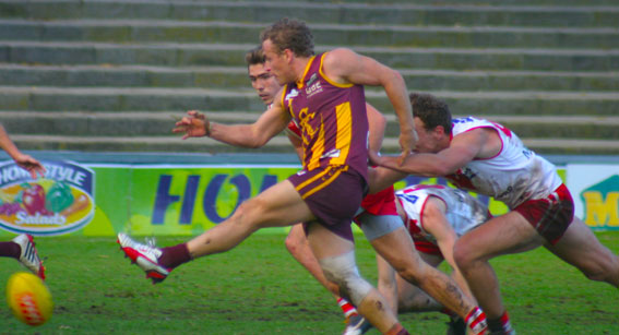 Jason Bristow boots the ball forward for Subiaco at Fremantle oval. Photo by Les Everett.