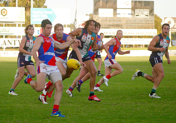 All eyes on West Perth's Kris Shannon as he drives the ball out of defence.