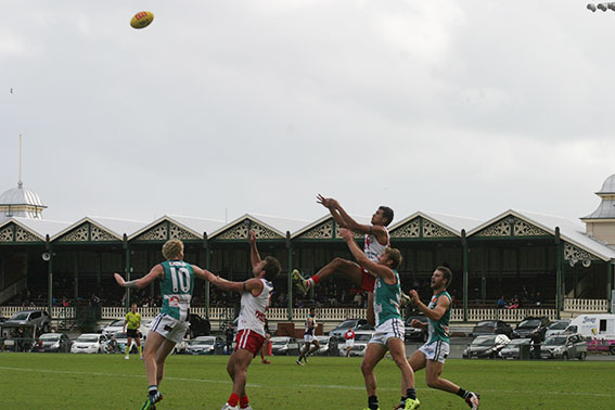 Callum Ah Chee rises on his way to the mark of the day at Fremantle Oval. Photo by Les Everett