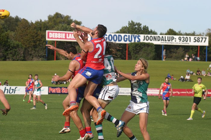 Spoiler: West Perth's Marcus Adams puts an end to a marking contest at Arena Joondalup. Photo by Les Everett