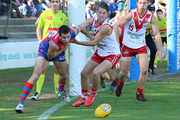Action close to the point post at Fremantle Oval. Photos by Les Everett